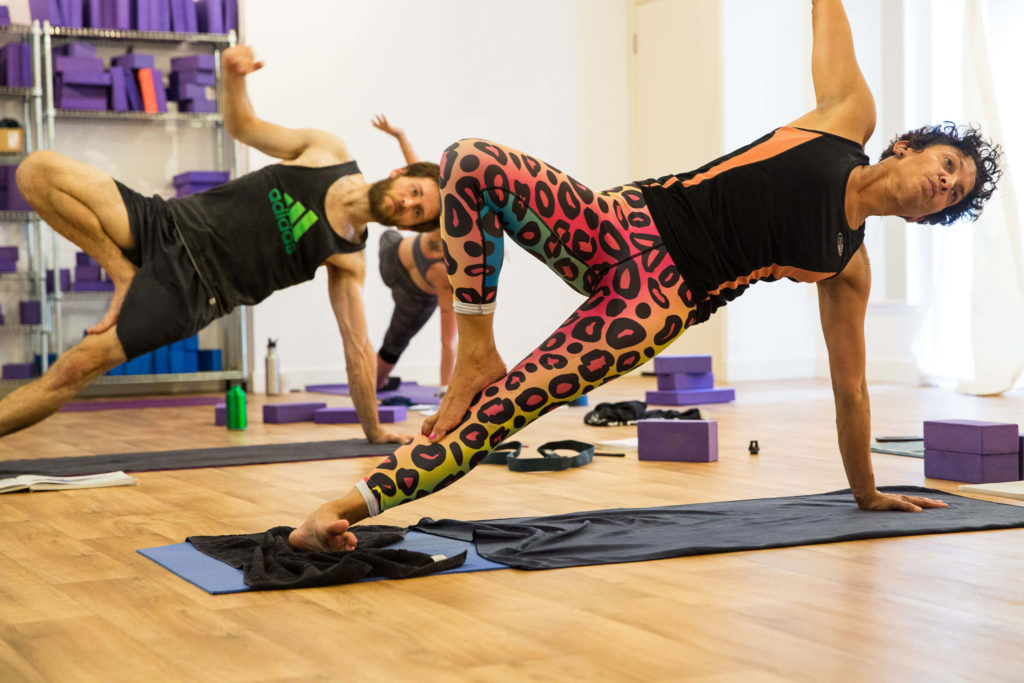 Teacher trainees showing the tree pose variation of side plank