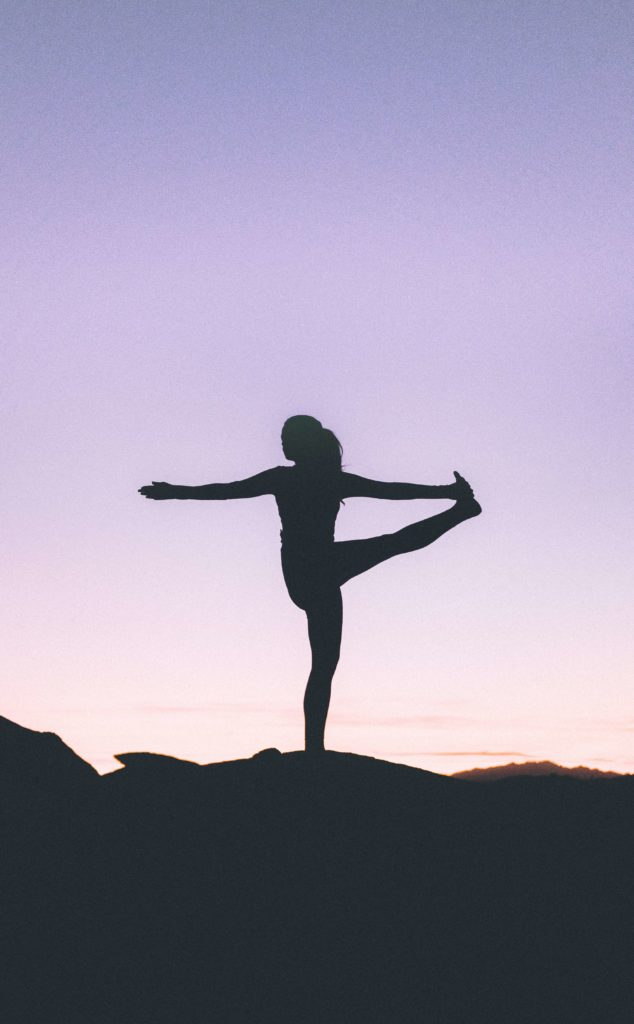 Dancing shiva pose practiced at sunset