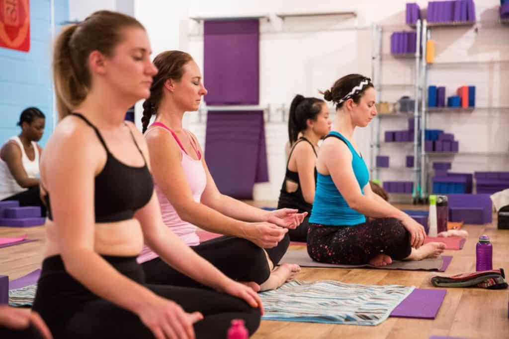 Teacher trainees meditating in class.