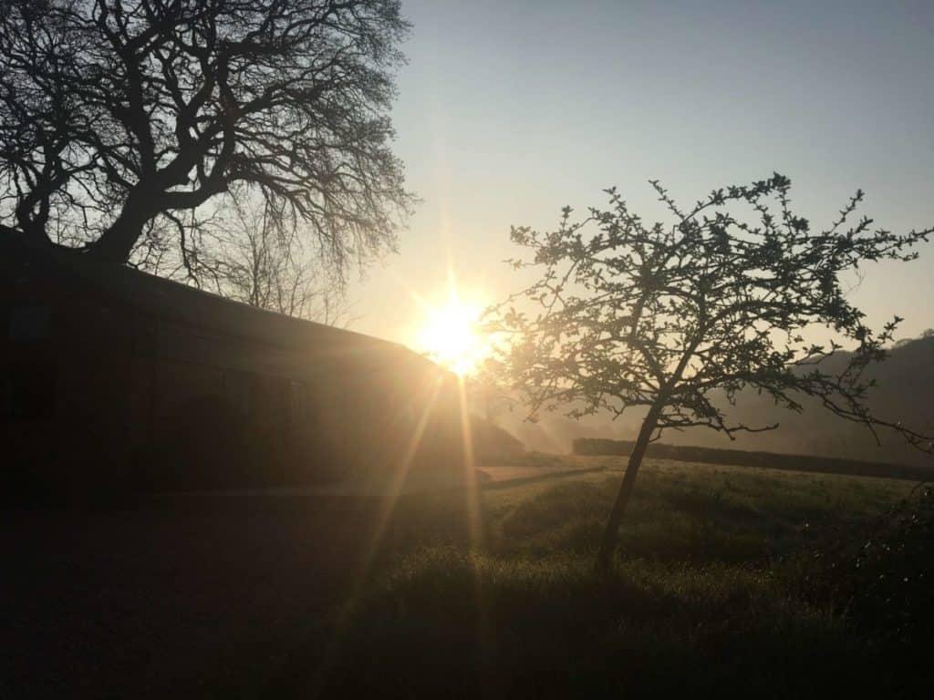 Sunrise over the hills at Yoga Retreat.