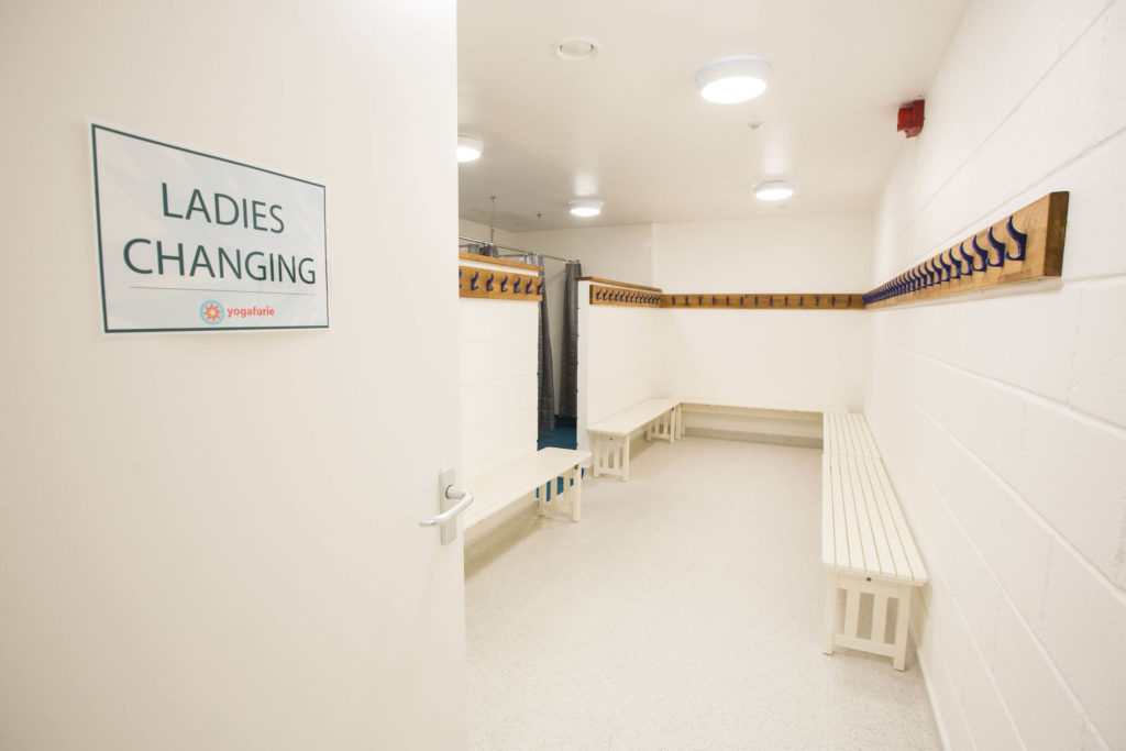 Ladies Changing room sign, benches and hooks.