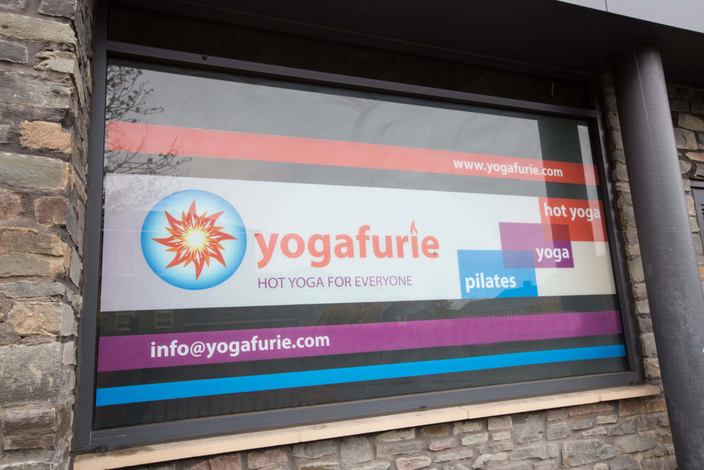 Vinyl windows - yogafurie branding and contact info printed.