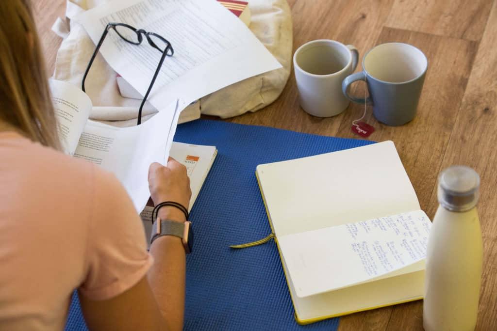 Teacher Trainee with books, tea, coffee and water.