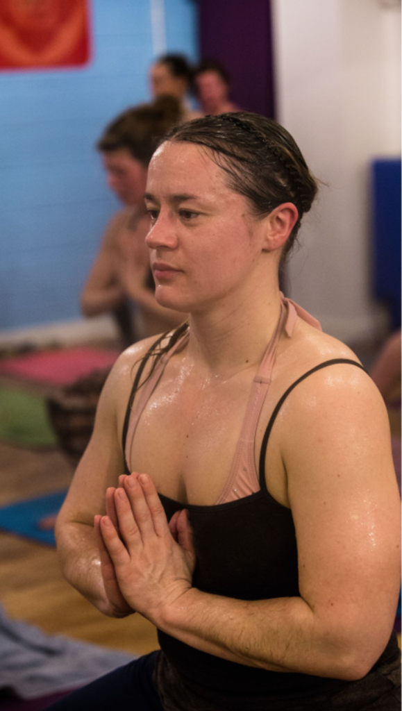 Amy Harrowell in hot yoga class.