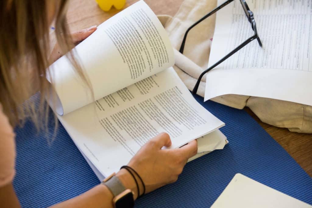 Yoga book club, woman reading a book