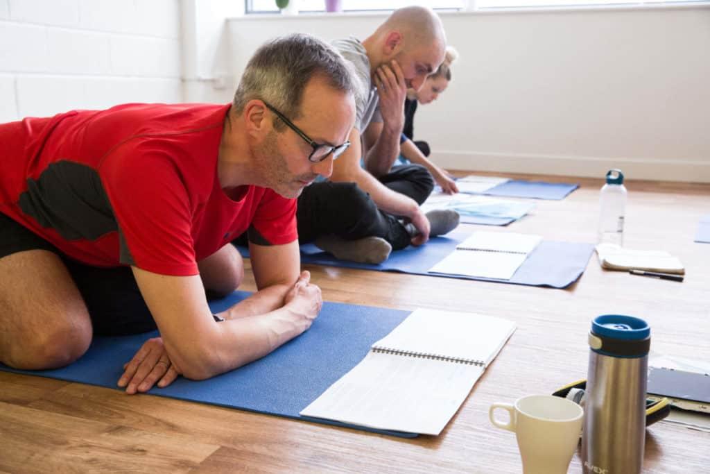 Yoga book club, man reading