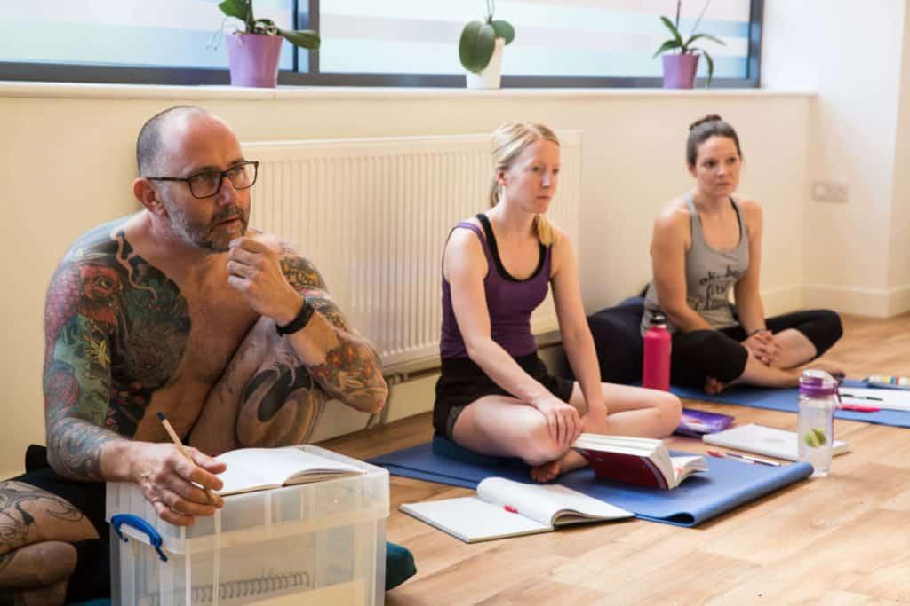 Yoga book club, man looking thoughtful