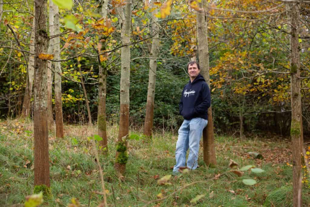 A man outdoors enjoying trees for Yoga book club