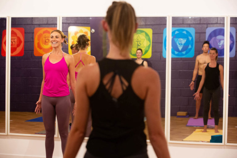 Lady smiling whilst teaching on a yoga teacher training course in bristol
