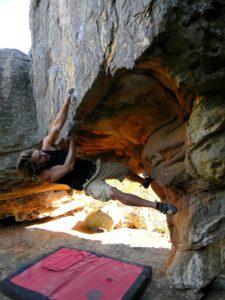 Climber Yogi scaling a rock face