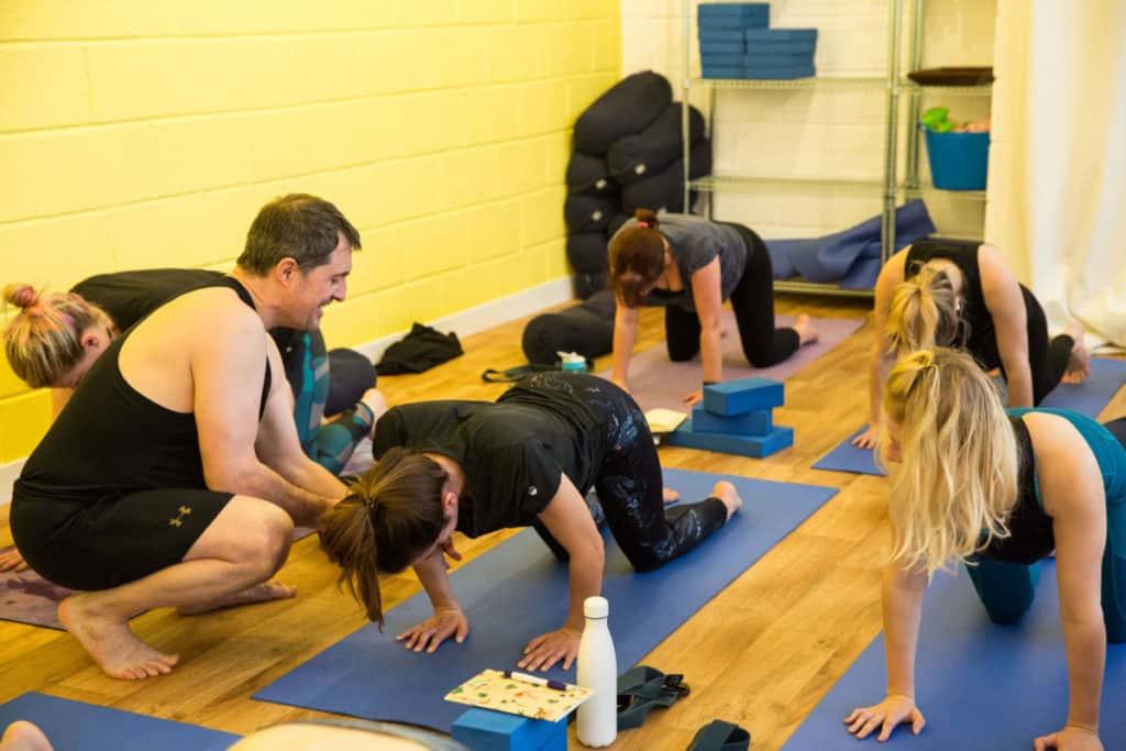 Ed assisting a yoga student
