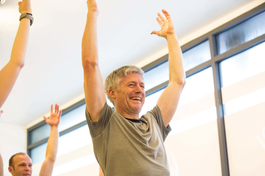man enjoying learning how to become a yoga teacher