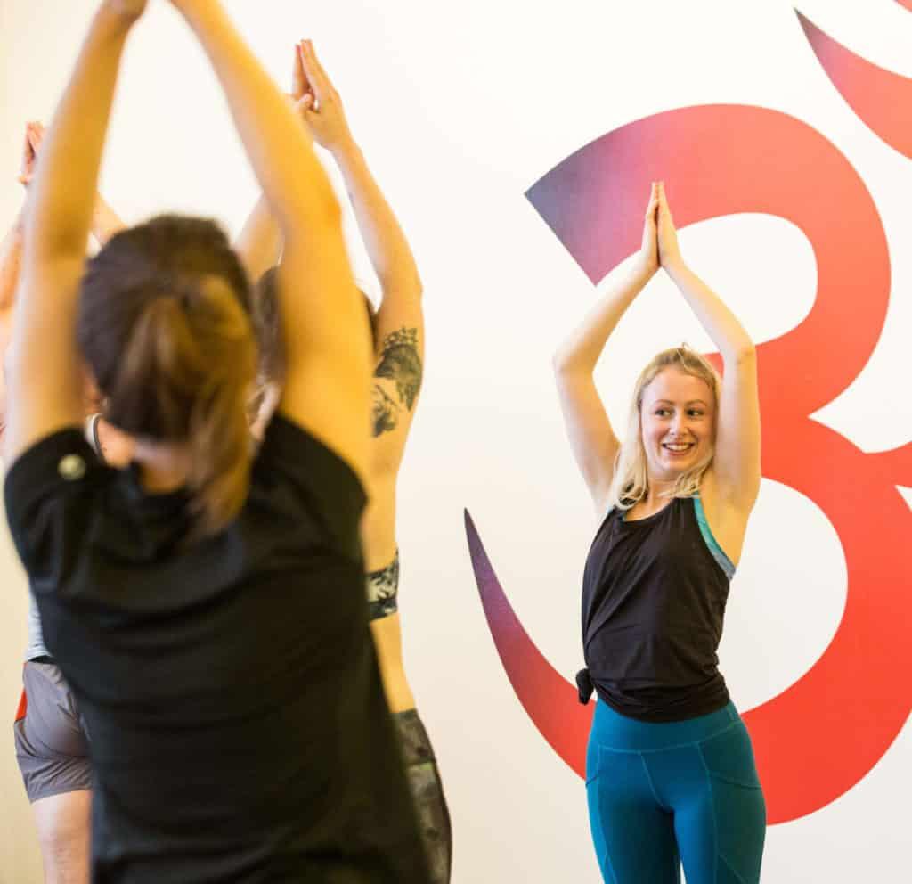 Ella practices teaching yoga whilst on yoga teacher training