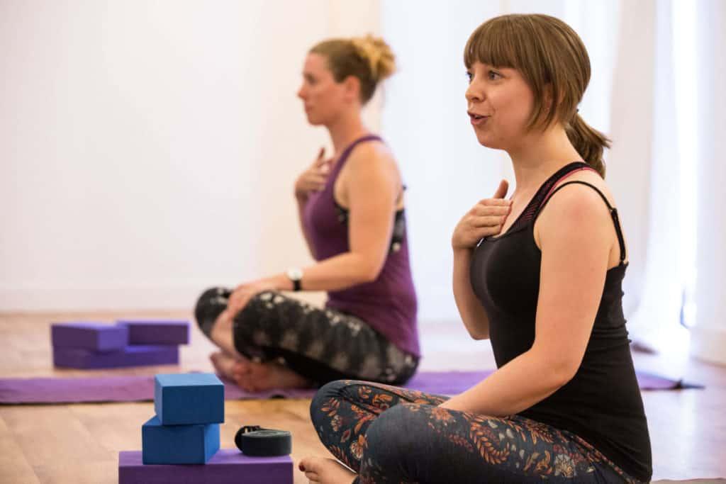 joy relaxing into her yoga teaching style