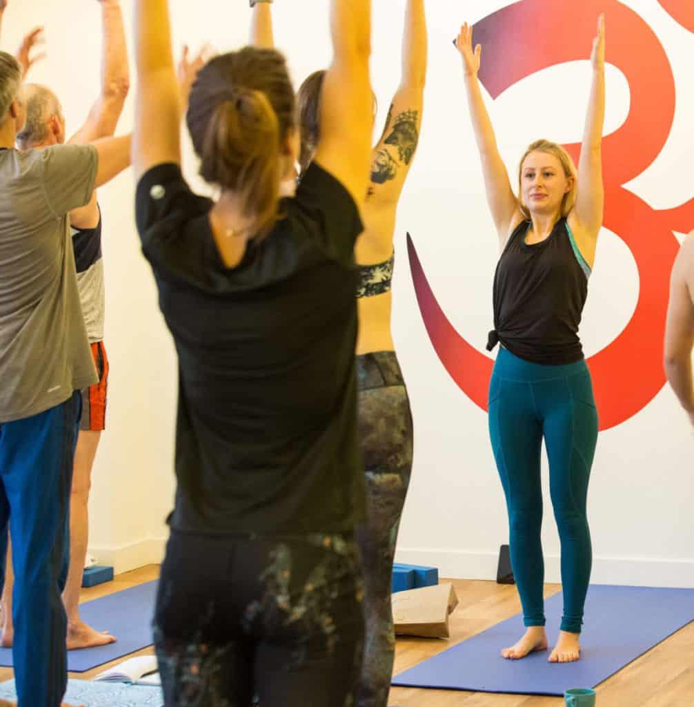 Ella teaching yoga in bristol