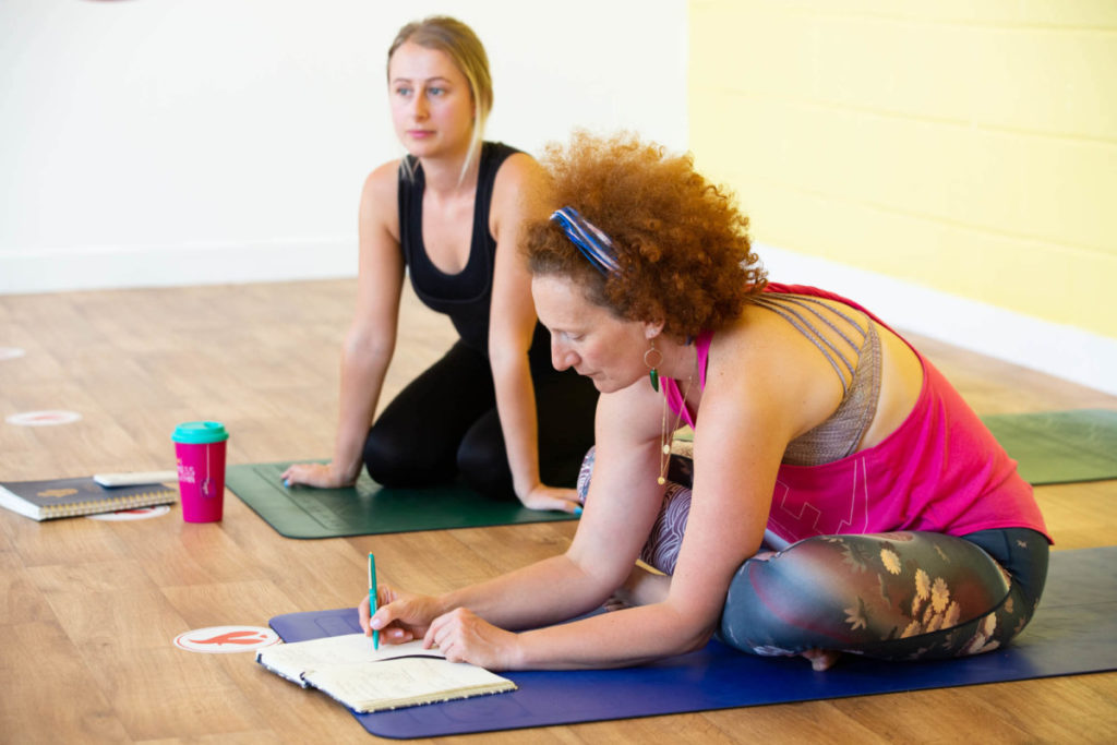 yoga book club, woman writing