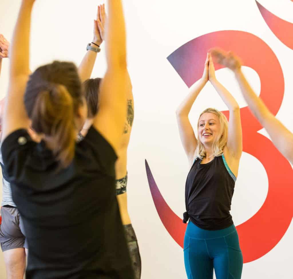 woman teaching yoga class, yoga as a career path