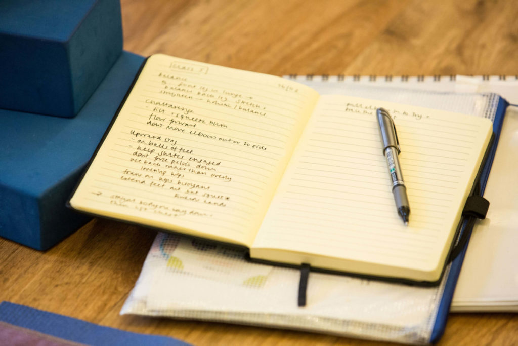 notepad and pen, james' interest in breathwork grew on his yoga course in Bristol