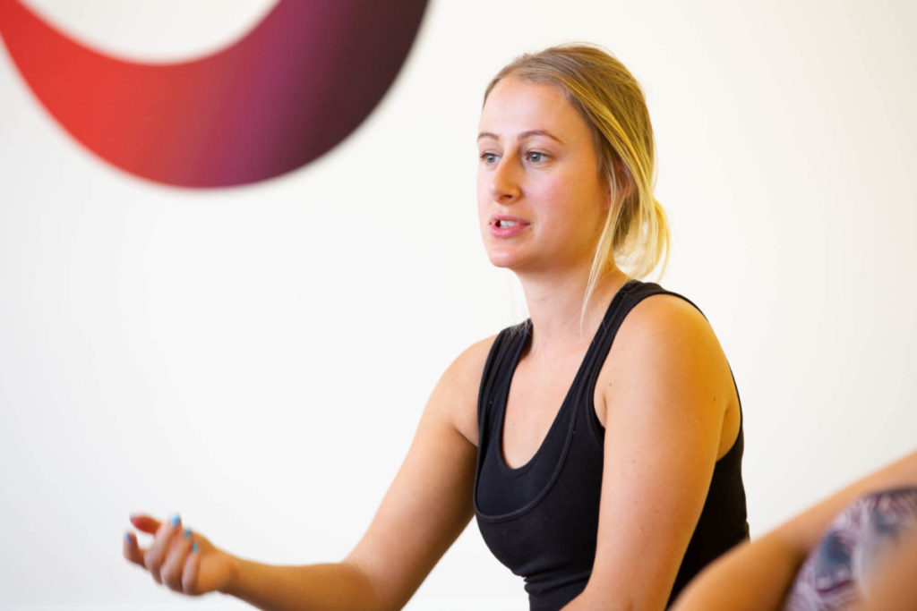 Ella grows throughout her yoga teacher training journey by putting herself out there