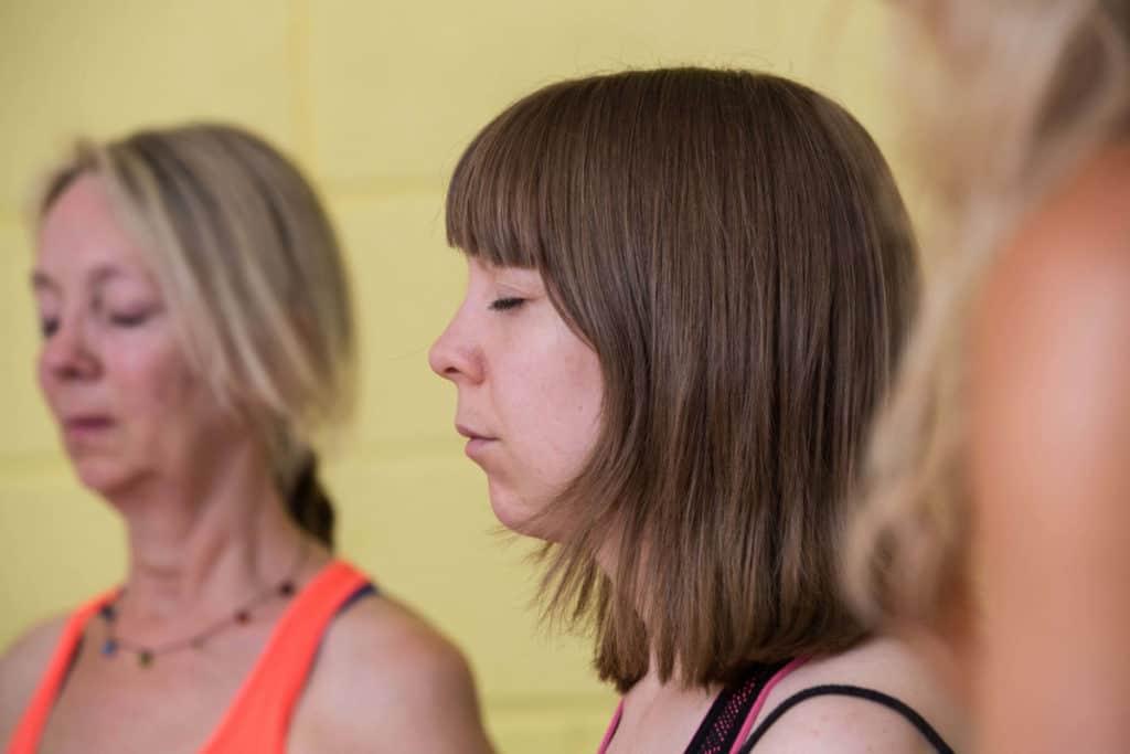 lady meditating on her yoga teacher training course