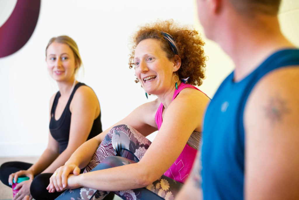 Lady smiling with Ella on Yogafurie's teacher training course