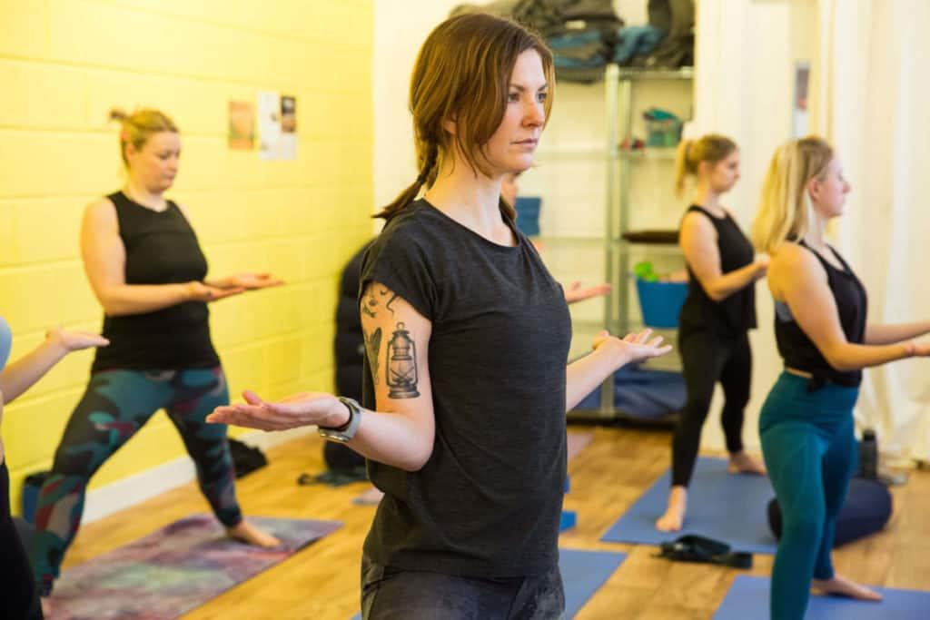 lady practices yoga in bristol yoga teacher training