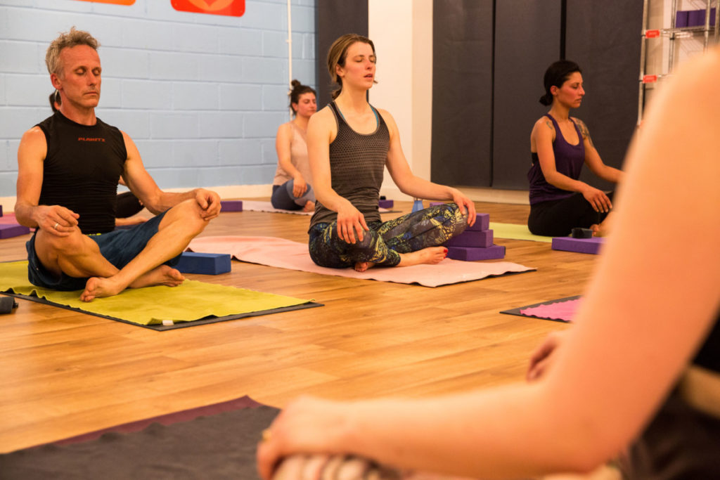 People learning how to breathe well using pranayama in a Hot Yoga class in Bristol